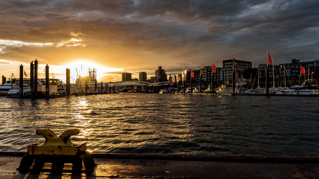 port of hamburg Backlight Elbe River Flaggs Hamburg Harbour Sunlight Architecture Building Exterior Built Structure City Cityscape Cloud - Sky Day Harbourscape Nature Nautical Vessel Outdoors Real People River Sky Sunset Travel Destinations Water Überseebrücke