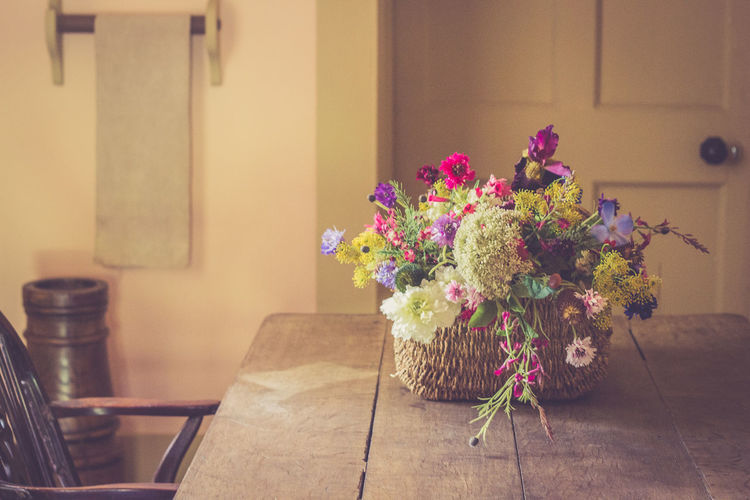 Arrangement Bouquet Chair Day Flower Fragility Freshness Home Interior Indoors  Nature No People Table Vase Vintage