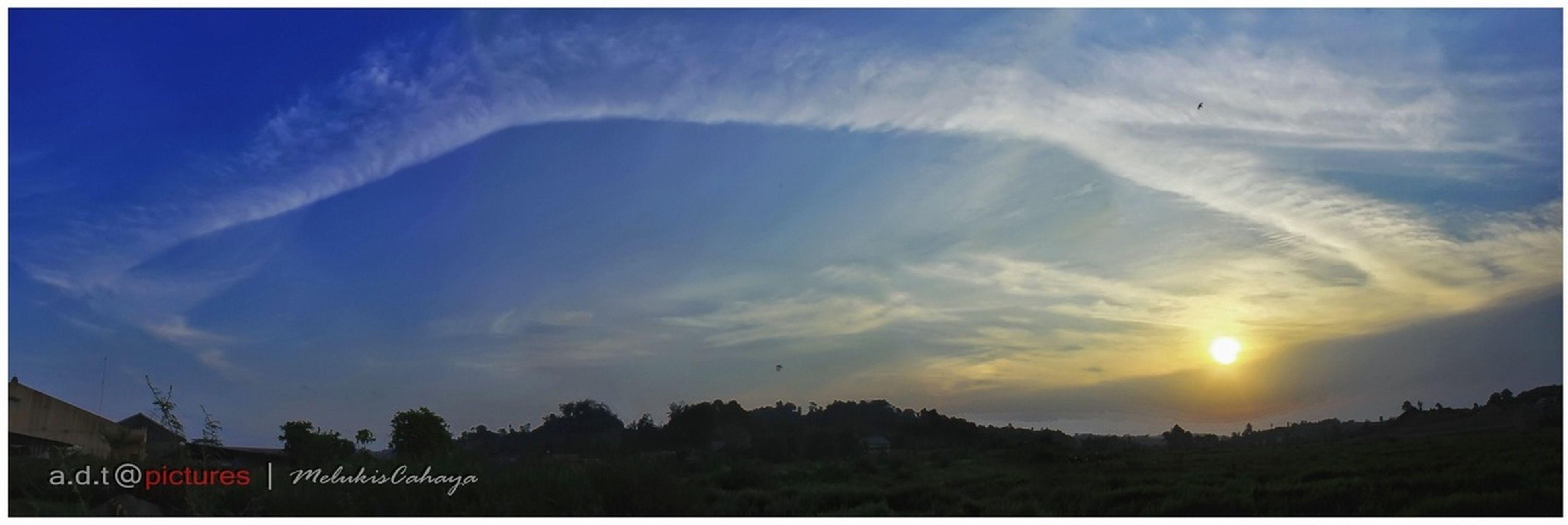 sunset, sky, scenics, beauty in nature, transfer print, silhouette, tranquil scene, sun, cloud - sky, landscape, tranquility, auto post production filter, nature, orange color, idyllic, sunlight, mountain, cloud, outdoors, transportation