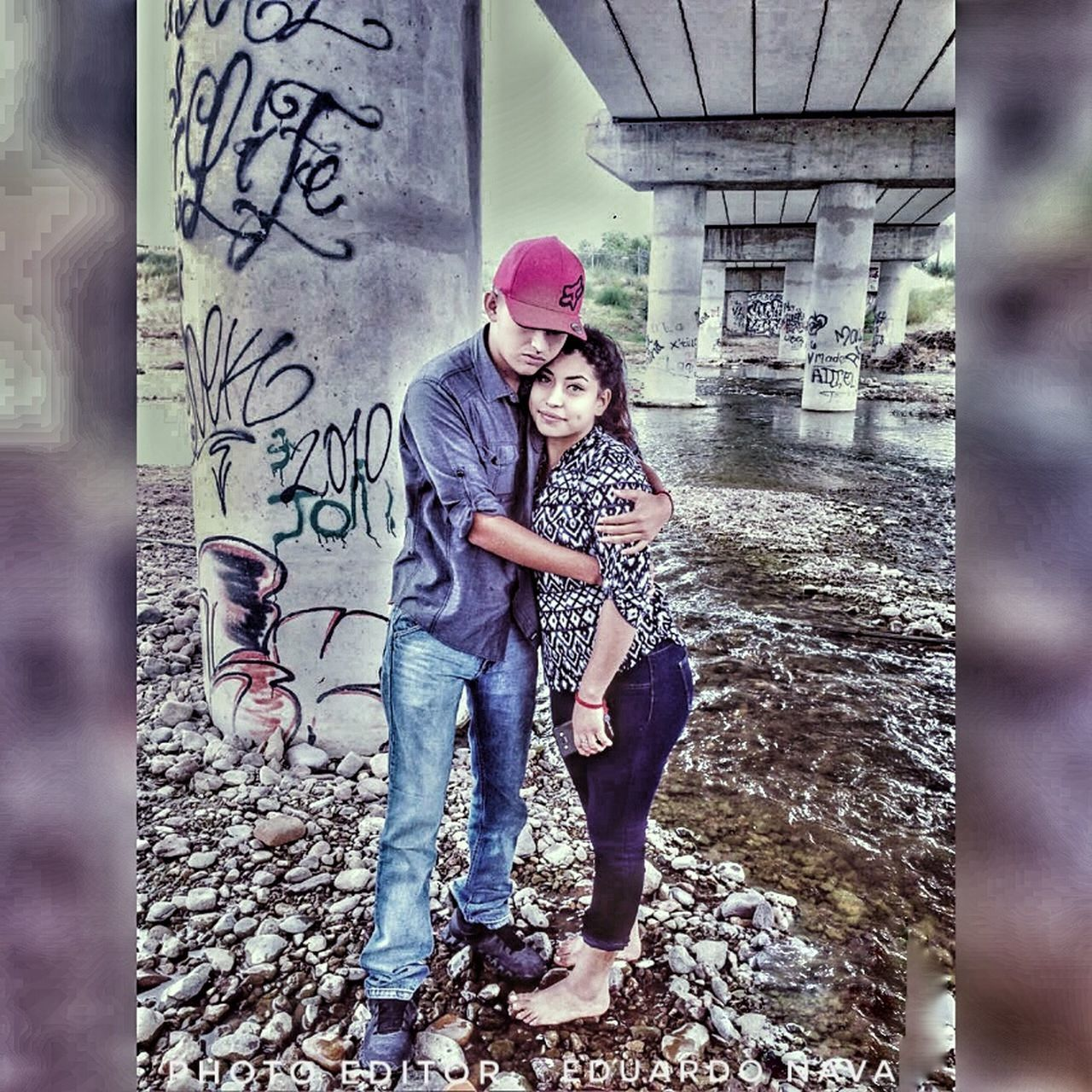 young women, graffiti, young adult, two people, togetherness, full length, casual clothing, love, happiness, smiling, women, real people, lifestyles, friendship, day, standing, outdoors, cheerful, portrait, bonding, beauty, beautiful woman, beautiful people, adult, youth culture, people, city, adults only