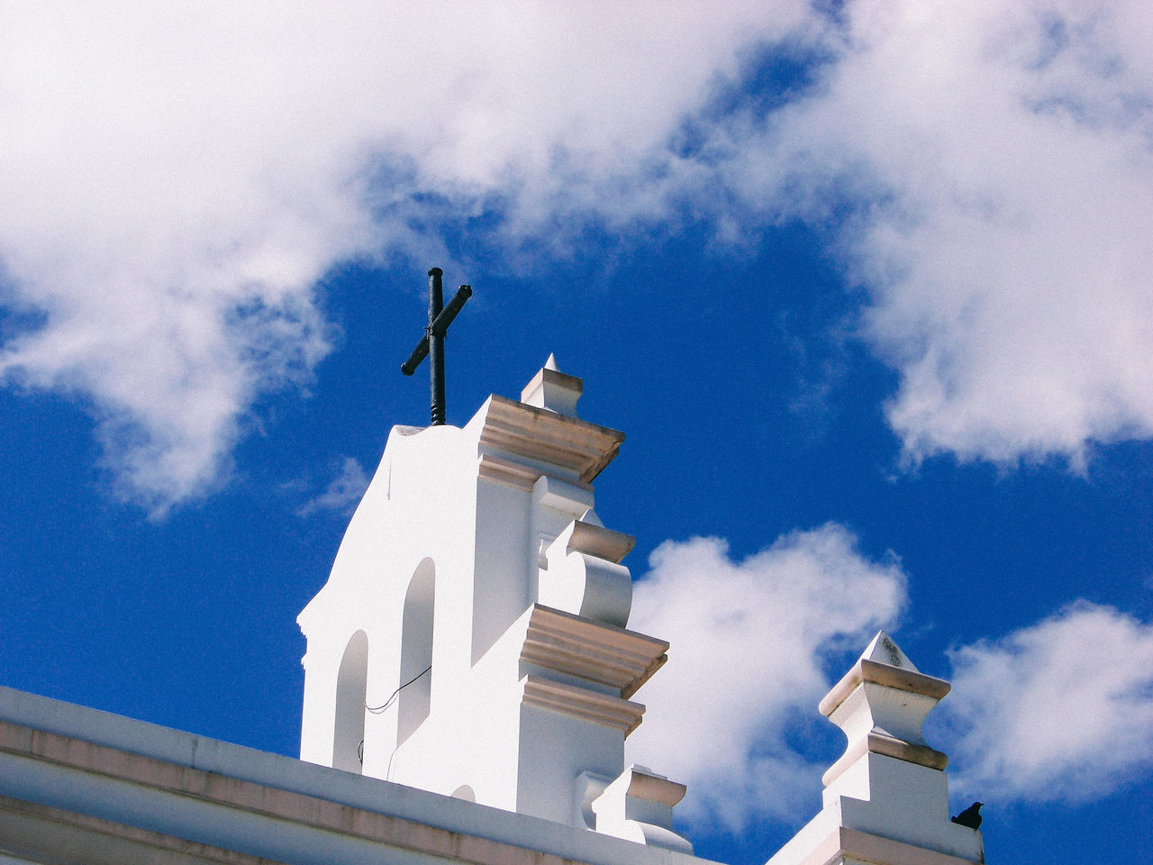 architecture, sky, built structure, cloud - sky, low angle view, statue, building exterior, day, outdoors, religion, sculpture, place of worship, spirituality, no people, whitewashed, animal themes
