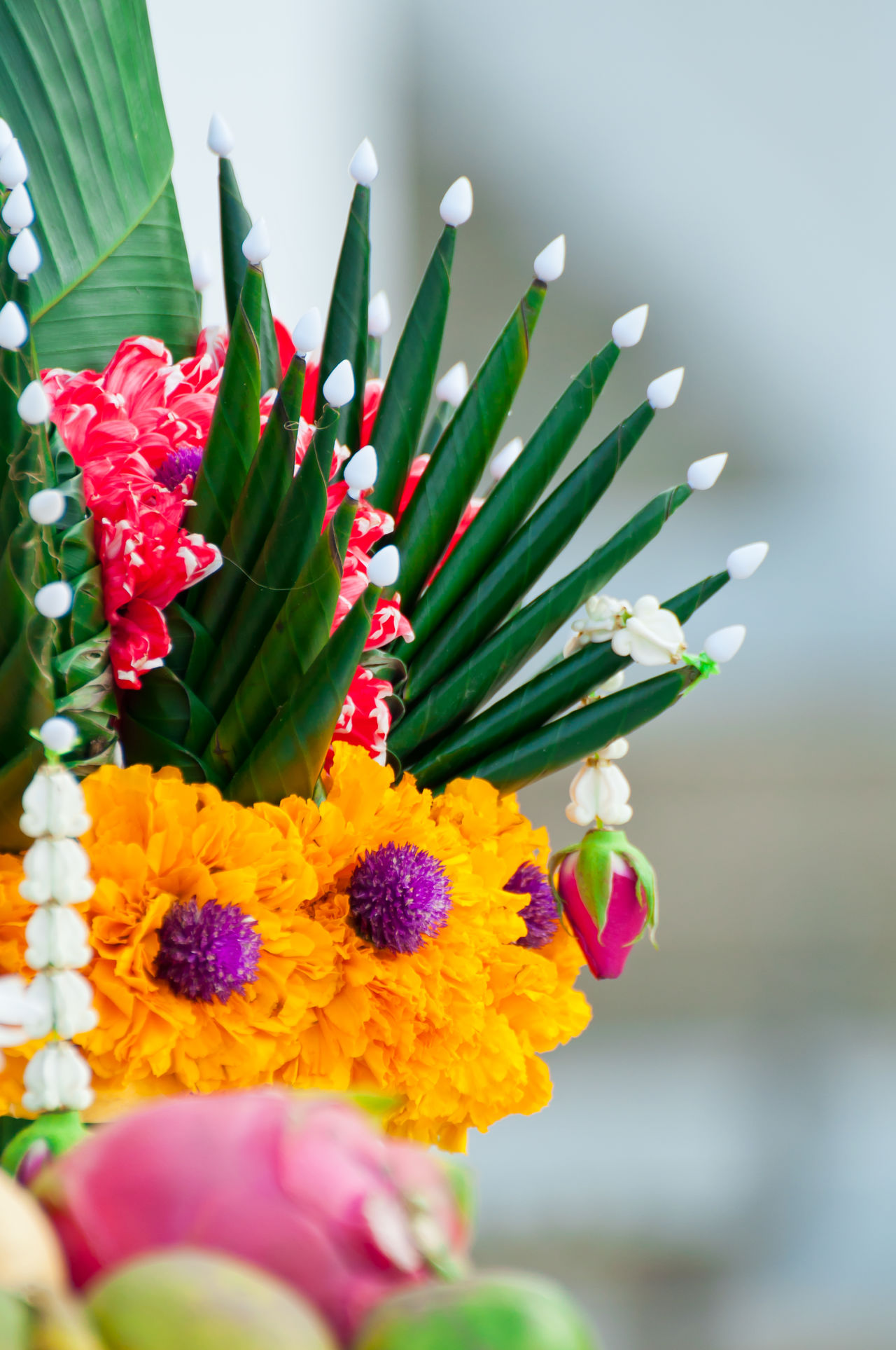 Garlands of flowers and sacrifice. For the idolatry of the king. Also known in Thailand as BAISǏI Amaranth BAISǏI Banana Leaf Believe Close-up Crown Flower Culture Faith Flower Fruits Gardenia Garlands Green Color Idolatry Multi Colored No People Ornament Rice Offering Sacrifice Thailand Worship Worshipping