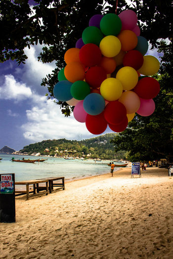 Beach Side Celebration Multi Colored Beach Balloon Sky Idyllic Scenics Sea Water Outdoors Vacations Large Group Of People Nature Postcard People Day