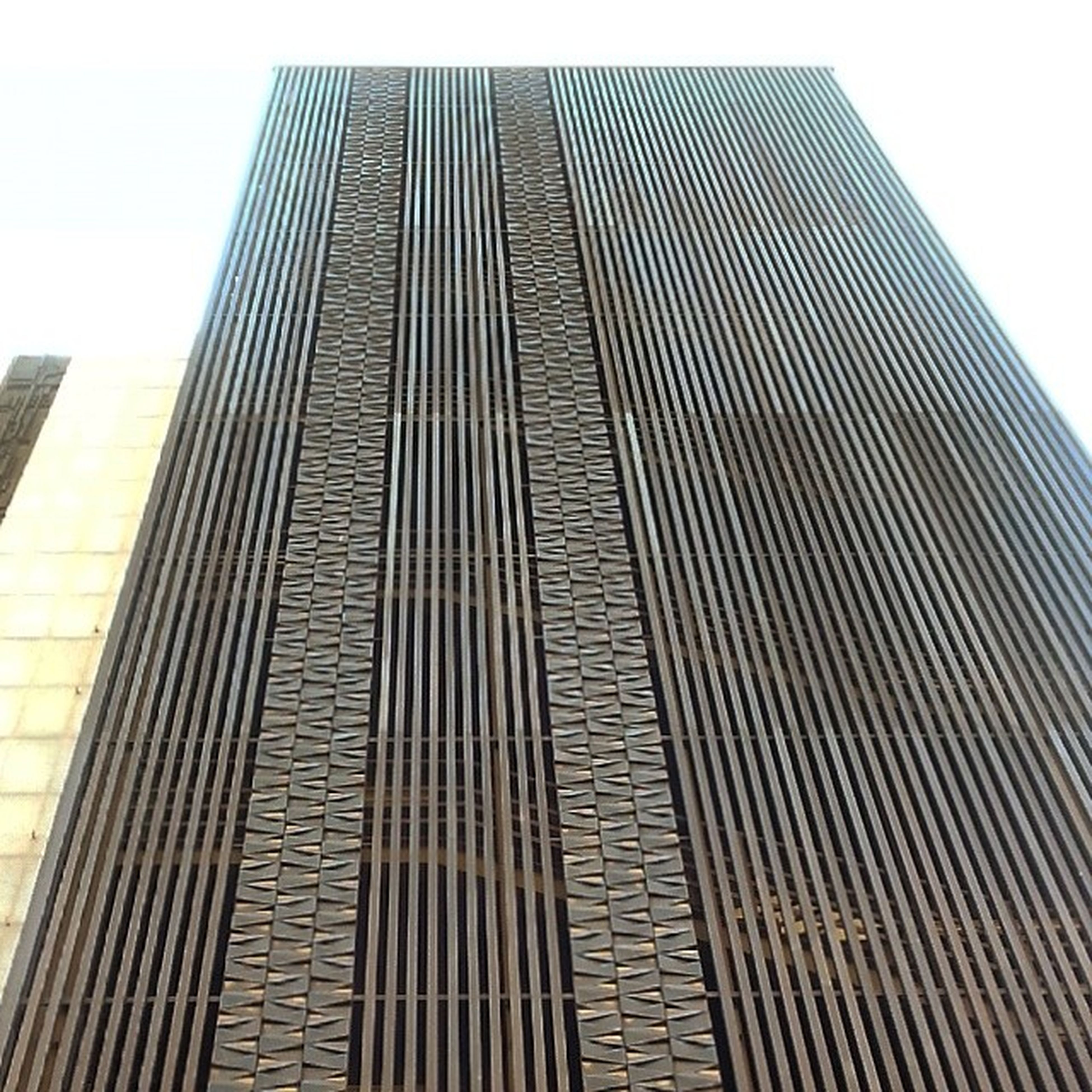 architecture, built structure, building exterior, skyscraper, low angle view, modern, tall - high, office building, city, pattern, tower, building, clear sky, repetition, sky, tall, day, no people, outdoors, diminishing perspective