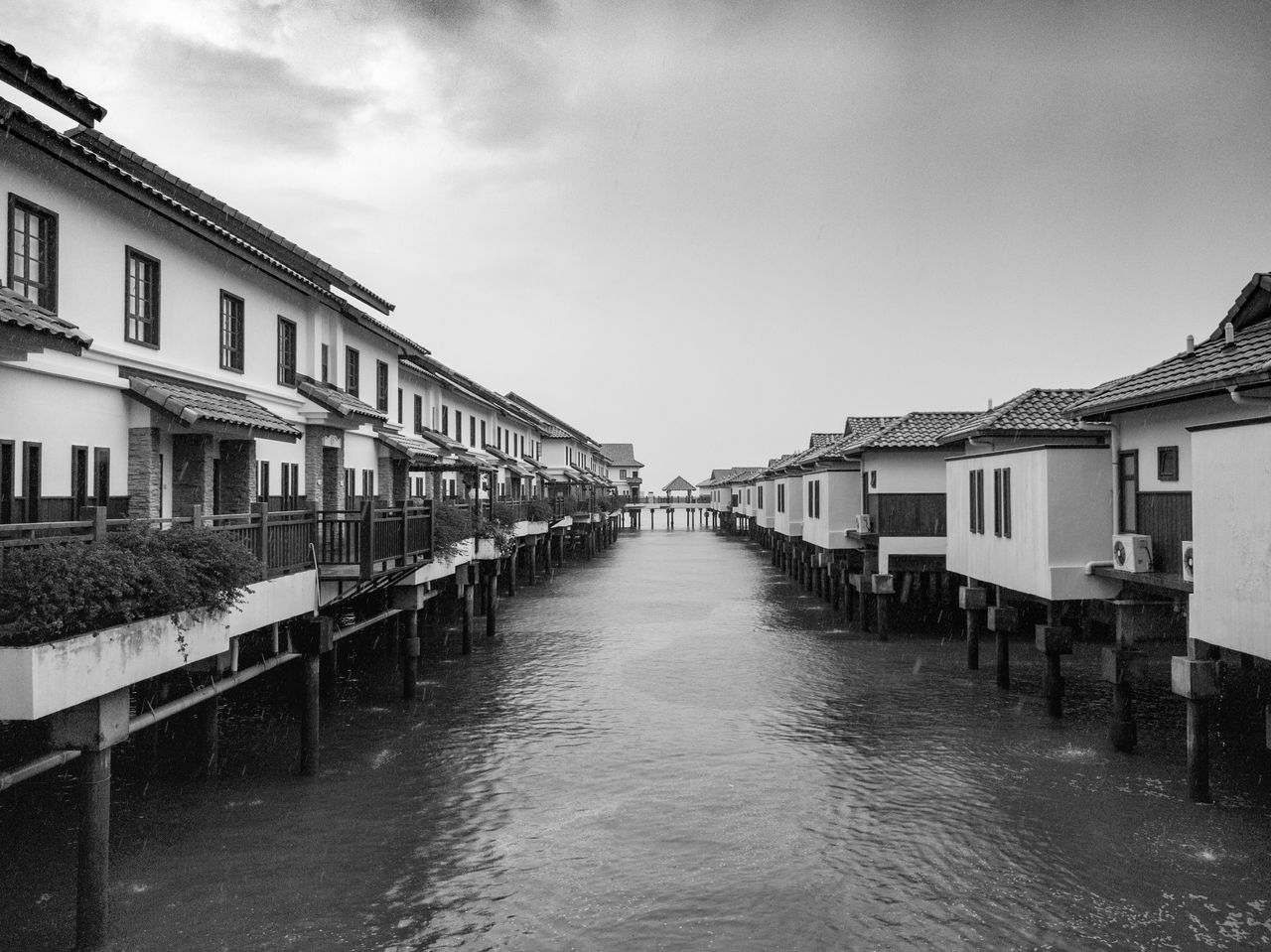 In perspective toward the horizon in black and white Architecture Building Exterior Built Structure Water Waterfront Day Sky Outdoors No People Water Chalet Chalet
