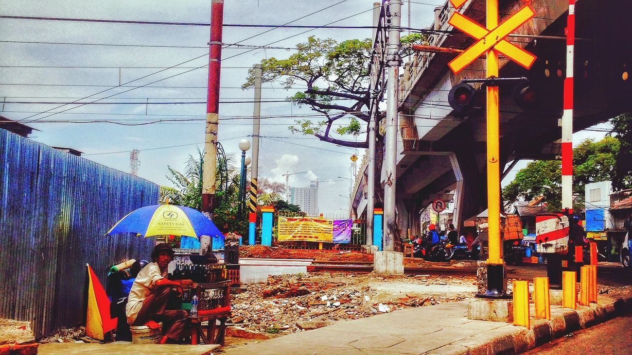 Streetphotography One Person Umbrella Crossing Rail Road Sign Board Umbrellas Umbrella Street Umbrella☂☂ One Person Watching Eyeem4photography
