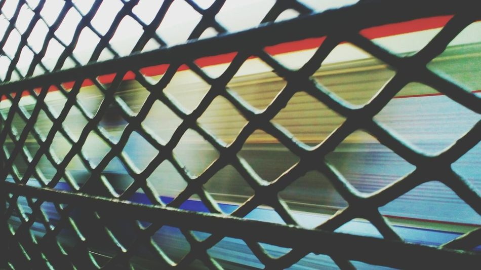 Chainlink Fence Safety Crisscross Chainlink Pattern Metal Full Frame MotoClick Beginner Mobilephotography Beginnerphotographer Backgrounds Railroad Station Platform Window Public Transportation Rail Transportation Indiantrains Railroad Track Train - Vehicle Transportation Mode Of Transport Leisure Activity