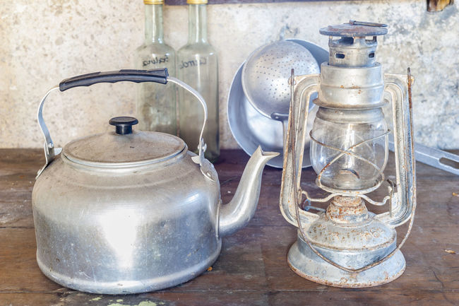 Old objects once: aluminum kettle and old acetylene lamp Accessories Bottles Colander Gas Indoors  Kitchen Kitchen Utensil Lamp Lantern Man Made Object No People Pan Portrait Rural Rustic Tool