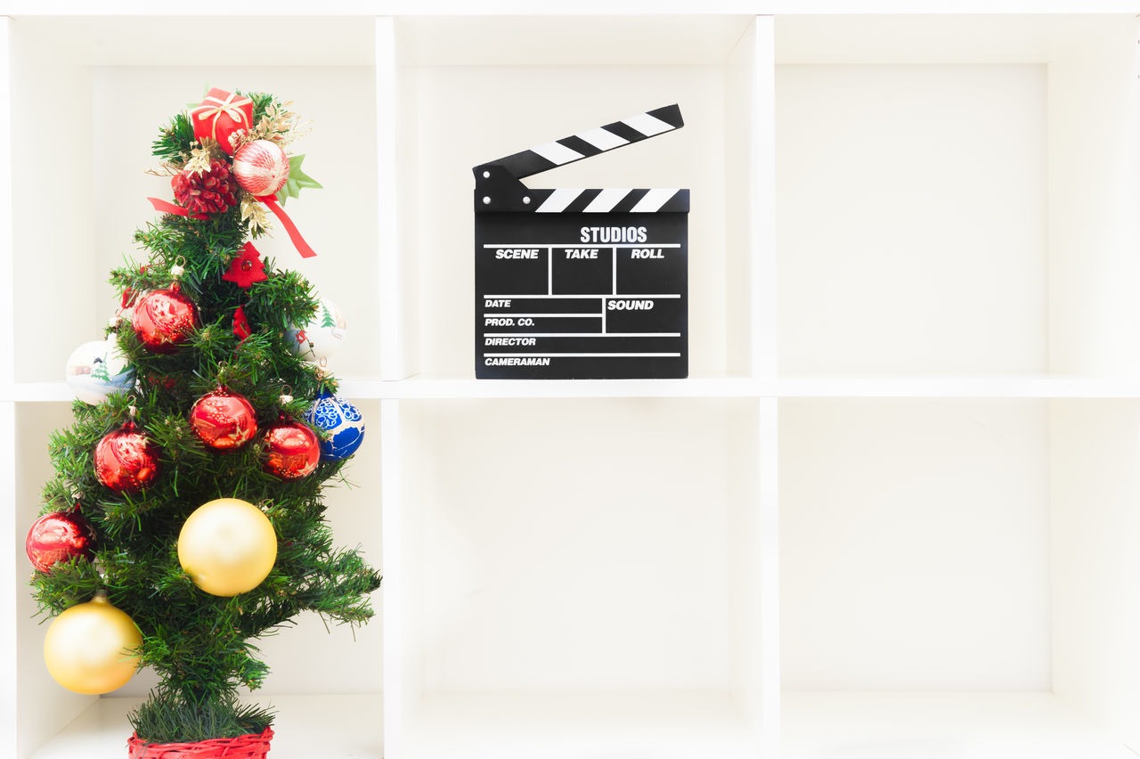 Christmas movie symbol Christmas Christmas Tree Cinema Clapper Clapper Board Clapperboard Film Holidays MOVIE No People Red Shelf Symbol Winter