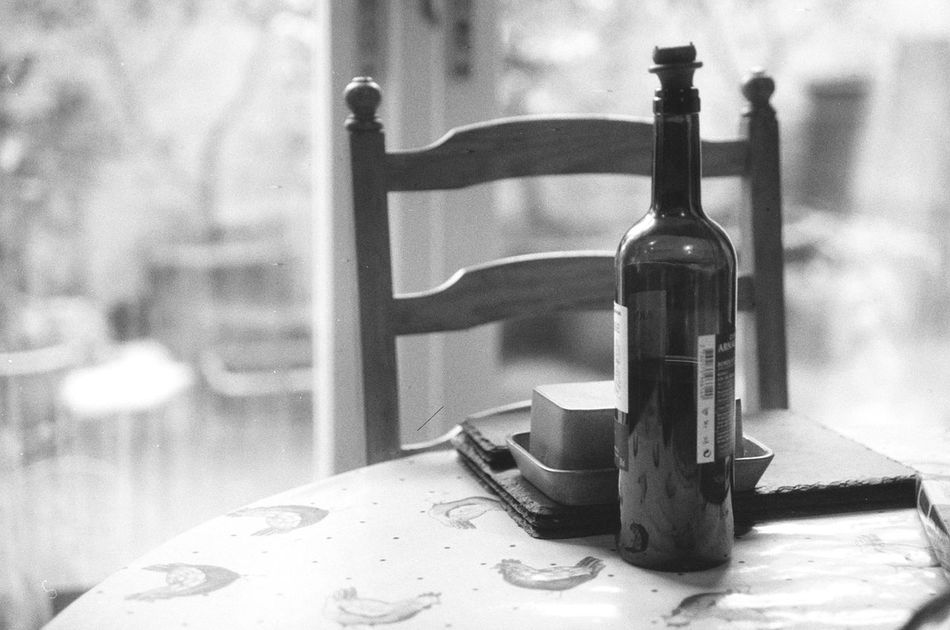 Black And White Blackandwhite Blackandwhite Photography Canon EOS 500N Close-up Film Is Not Dead Film Photography Filmisnotdead Filmphotography Focus On Foreground Ishootfilm Lucky Film No People Table Wine Wine Bottle