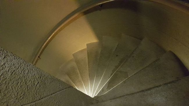 Indoors  Wall - Building Feature Architecture Built Structure Illuminated Geometric Shape Modern Curve No People Circle Looking Down National Landmark Voortrekker Monument Pretoria From Where I Stand Looking Down! Tshwane Narrow Spiral Staircase