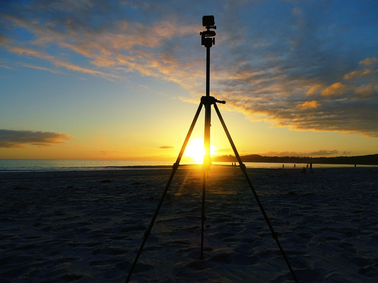 sunset, sea, sky, cloud - sky, tranquility, silhouette, water, beach, tranquil scene, scenics, beauty in nature, nature, sun, horizon over water, no people, outdoors, camera - photographic equipment