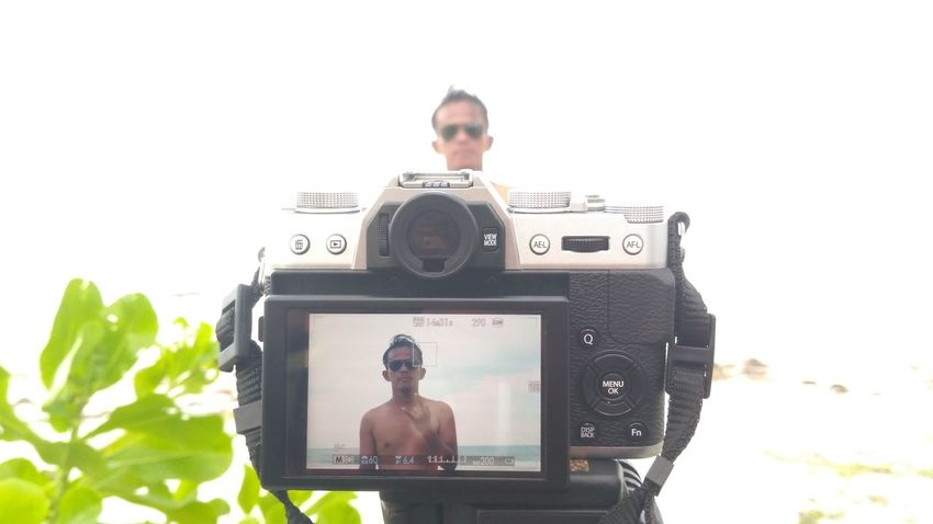 Photography Themes Camera - Photographic Equipment Photographing Technology Digital Camera Digital Single-lens Reflex Camera Adults Only One Person Men Only Men Device Screen Adult One Man Only People Day Photographer Young Adult Home Video Camera Outdoors Filming Rethink Things