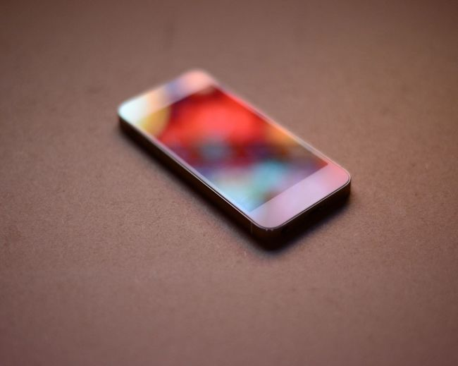 Blue Cigarette Lighter Close-up Focus On Foreground Indoors  Man Made Object Mobile Phone No People Portability Red Reflection Single Object Still Life