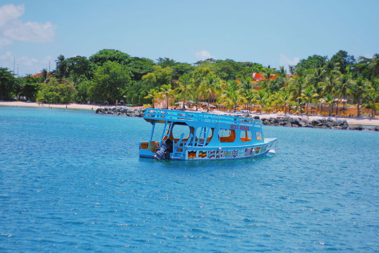 Travel Destinations Trinidad And Tobago Nature Photography Nature_collection Naturelovers Tourism Tourist Attraction  Tranquil Scene Tour Boat Glass Bottom Boat Caribbean Store Bay Beauty In Nature Nautical Vessel Tree Sea Beach Transportation Water Day Blue Vacations Nature Landscape An Eye For Travel