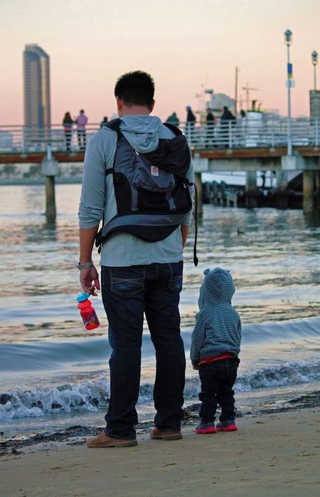 Modern Father Father and son watching the waves together at sunset facing San Diego city California. LikeFatherLikeSon Sunny San Diego☀ California No Filter Water The Traveler - 2015 EyeEm Awards pacific ocean Coronado Island RePicture Masculinity Love Without Boundaries Blue Wave