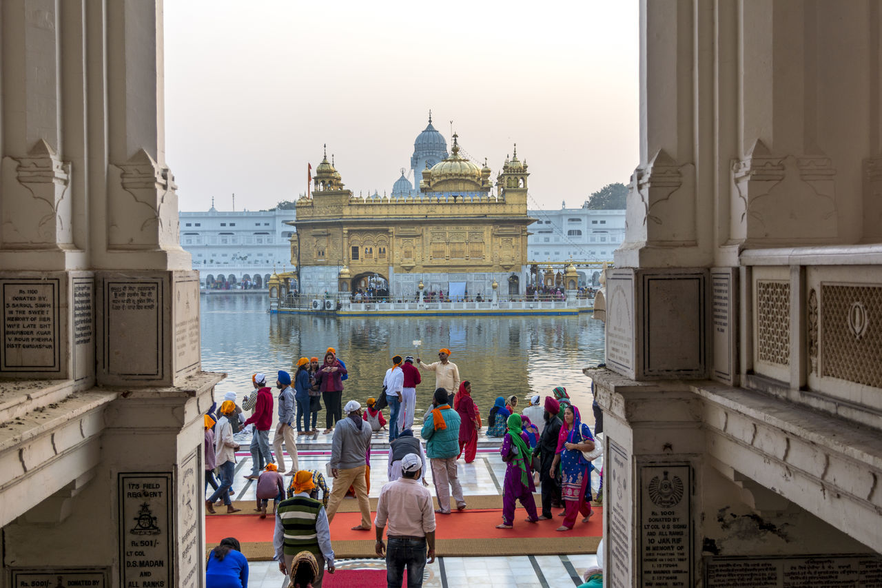 """Sri Harmandir Sahib (The abode of God), informally and popularly referred to as the """"Golden Temple"""",is the holiest Gurdwara of Sikhism, located in the city of Amritsar, Punjab, India. Amritsar (literally, the tank of nectar of immortality) was founded in 1577 by the fourth Sikh guru, Guru Ram Das. The fifth guru designed the Golden temple. As the name suggests, it is made of gold and Instead of ordinary custom of building temples on high ground Golden temple is built on a lower ground, so the devotees have to go down by steps to enter it, it shows humbleness and removing sense of superiority. It has four entrances which signify acceptance and openness. Hi Guyz,🙋🙋 i hope you all are good. I was so busy with work and then i needed little happy time so was out with friends.🏙🚗 Golden Temple Golden Temple, Amritsar Gurudwara Sikh Sikhism Sikh Temple People People Watching Place Of Worship Exceptional Photographs EyeEm Best Shots Street Photography Temple Temple - Building Taking Photos Enjoying Life Outdoors Places To Visit Gold Harminder Sahib People Photography People And Places Peoplephotography Water Water Reflections"""