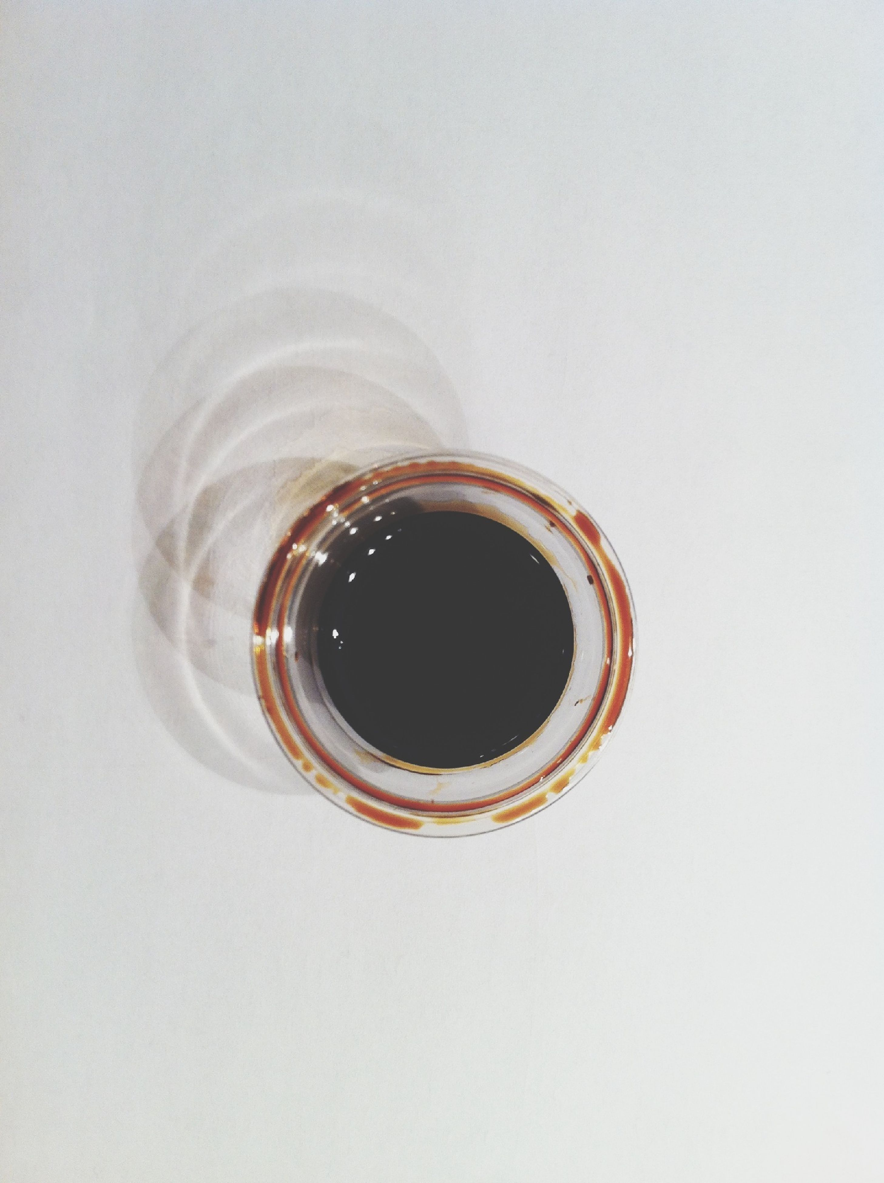 studio shot, white background, drink, close-up, indoors, still life, copy space, refreshment, single object, coffee cup, circle, directly above, food and drink, cup, freshness, no people, high angle view, coffee, geometric shape, table