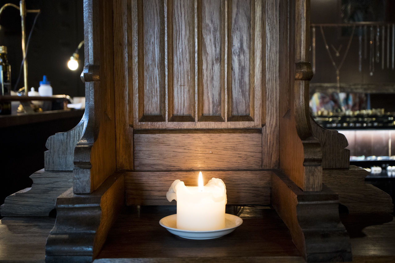 candle, flame, burning, illuminated, indoors, lighting equipment, heat - temperature, spirituality, table, no people, close-up, day