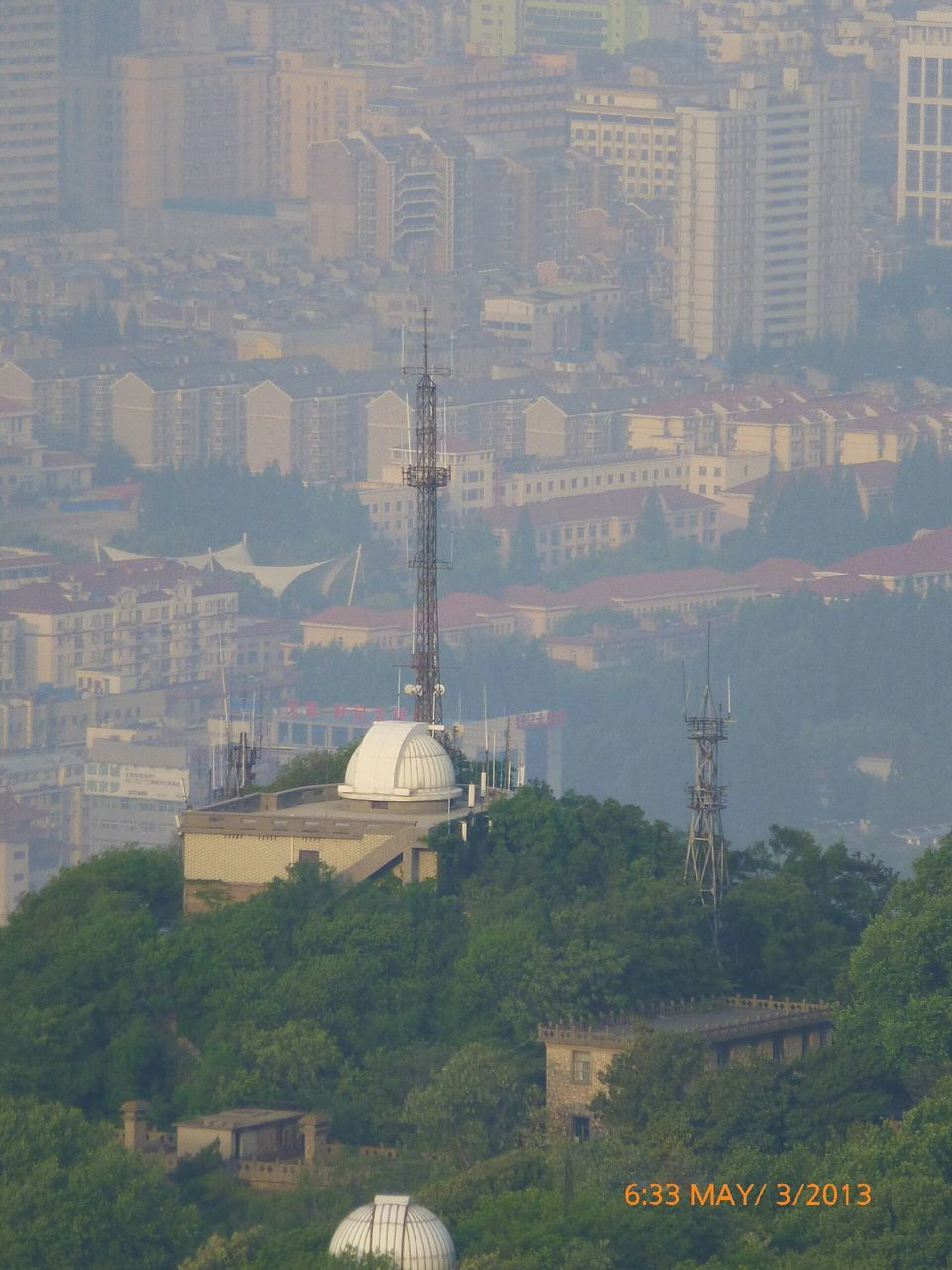 architecture, built structure, building exterior, communication, cityscape, tower, no people, city, day, connection, technology, outdoors, telecommunications equipment, tree, travel destinations, dome, nature