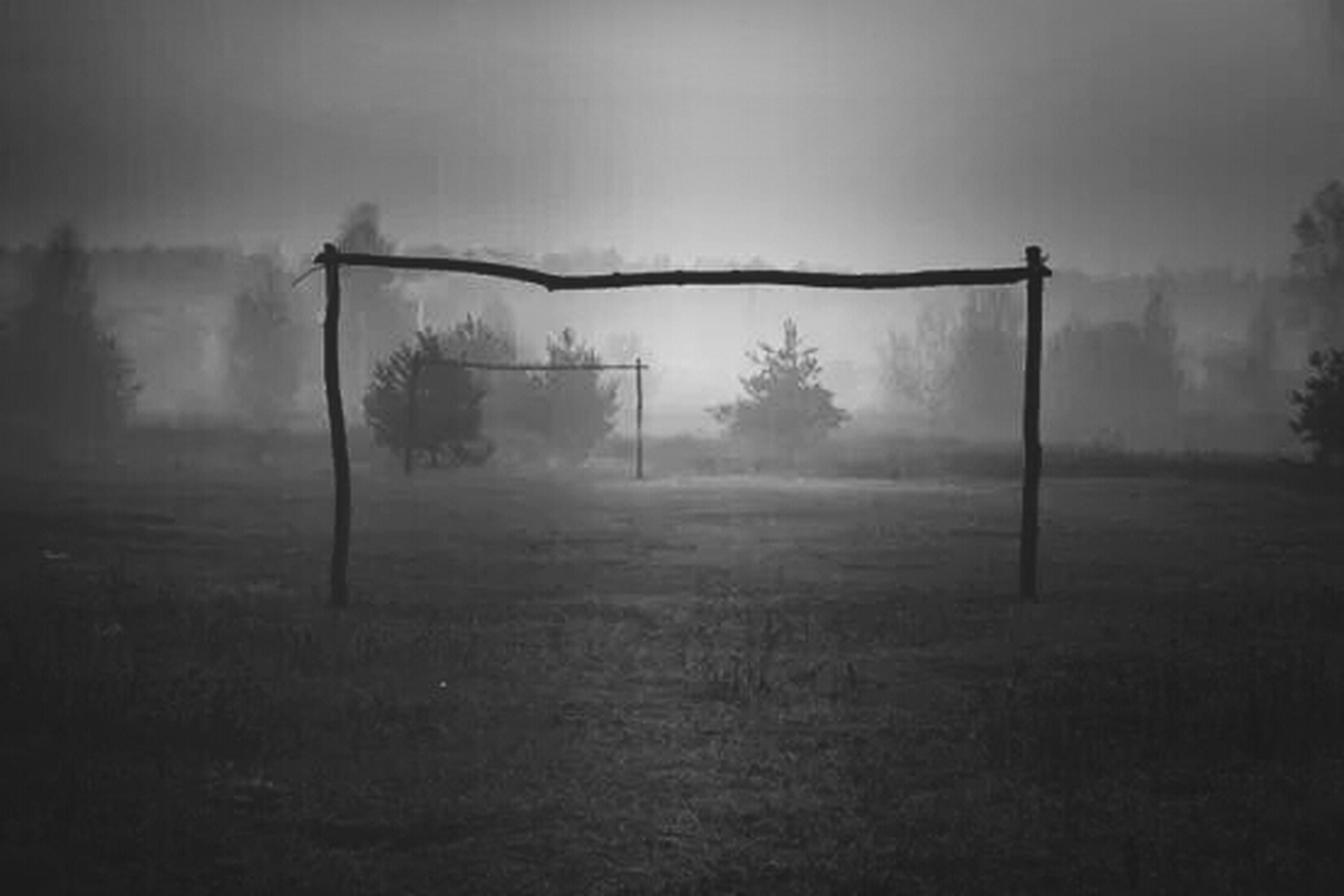 fog, foggy, field, weather, landscape, tranquility, tree, nature, grass, tranquil scene, built structure, sky, window, dusk, no people, house, silhouette, day, architecture, fence