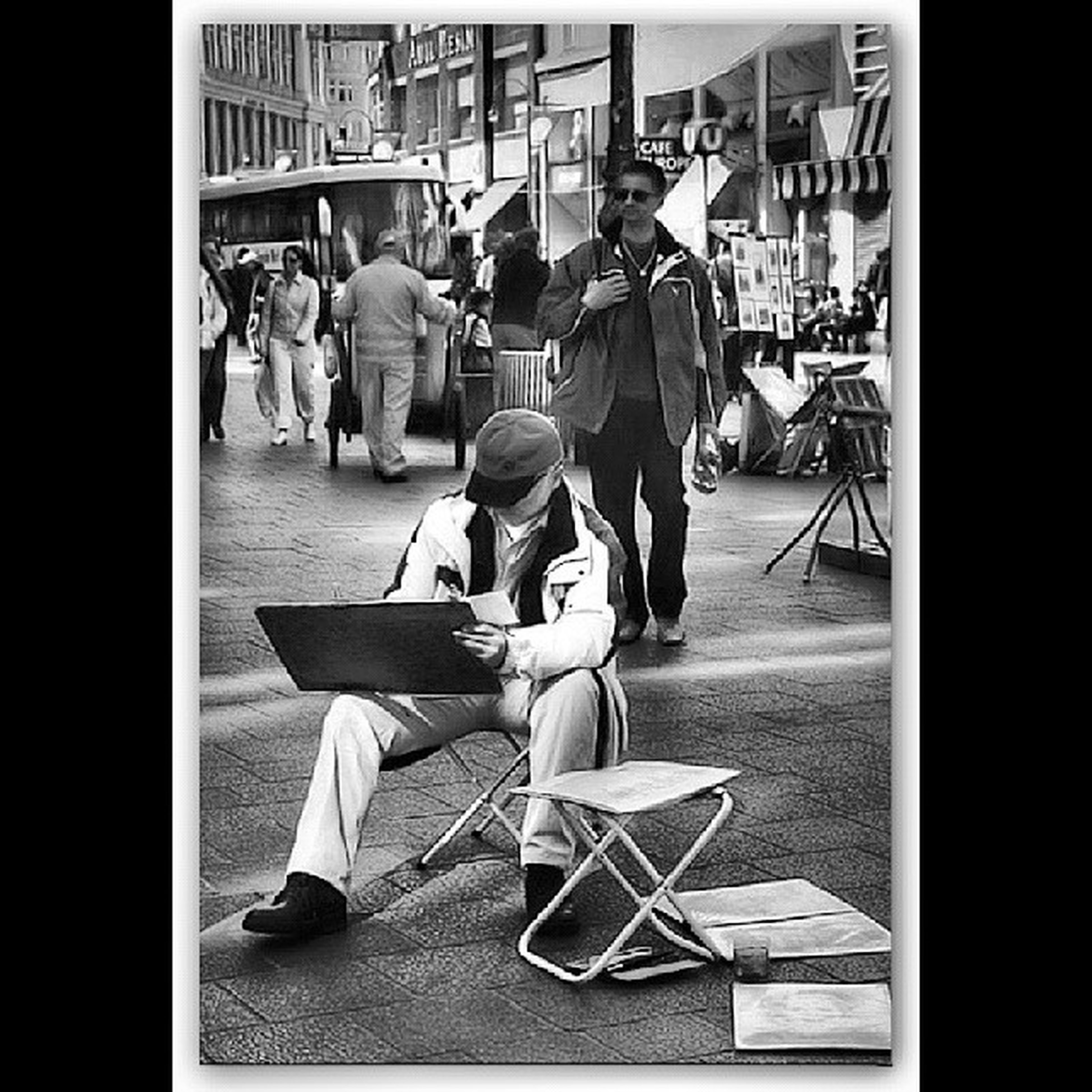 transfer print, men, chair, sitting, lifestyles, city, table, person, indoors, street, auto post production filter, sidewalk cafe, incidental people, city life, full length, rear view, leisure activity, restaurant