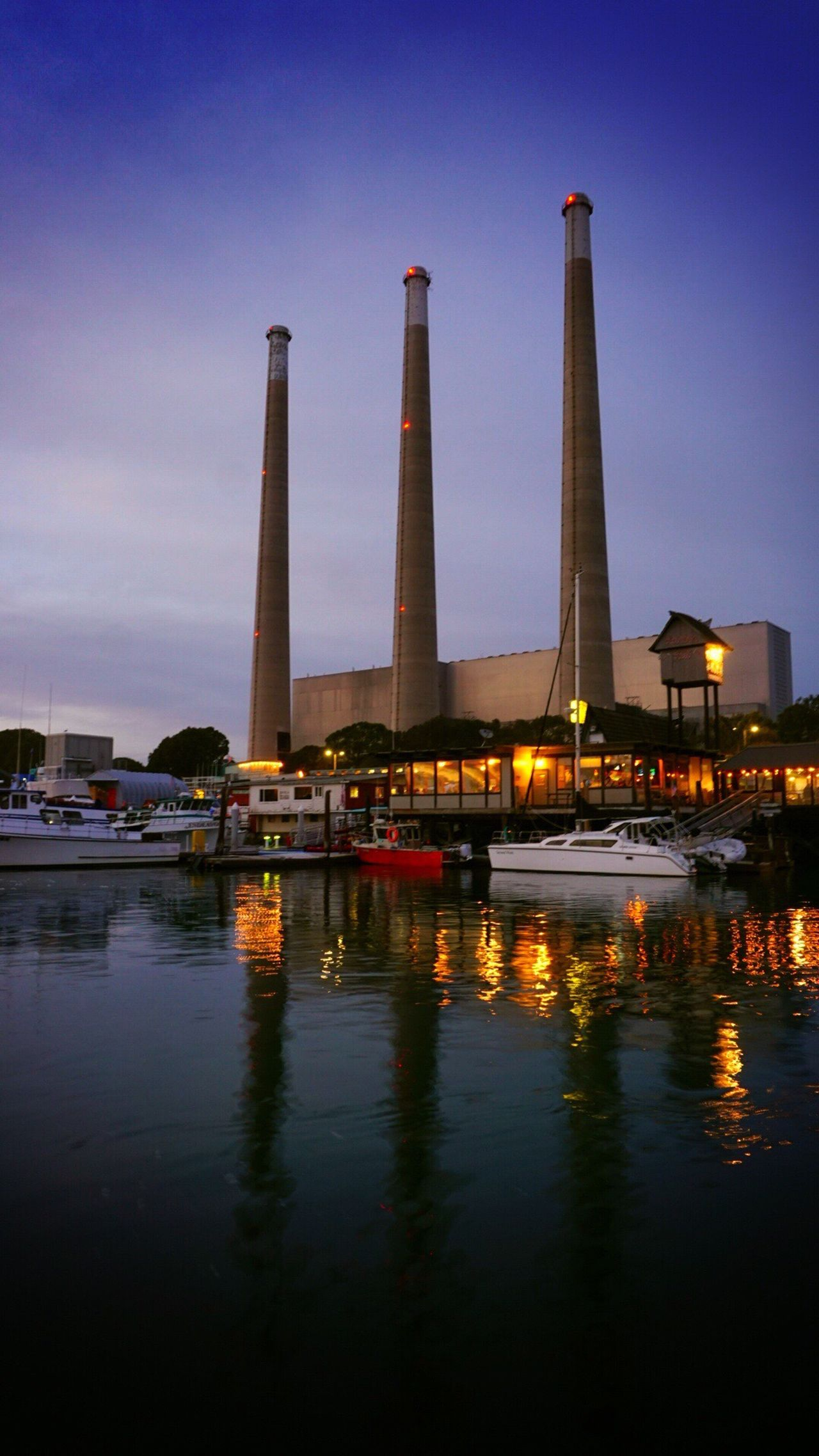 Reflection Sunset Water Sky Built Structure Architecture Waterfront Outdoors No People City Day Morro Bay, California Morro Bay Energy Plant Ocean