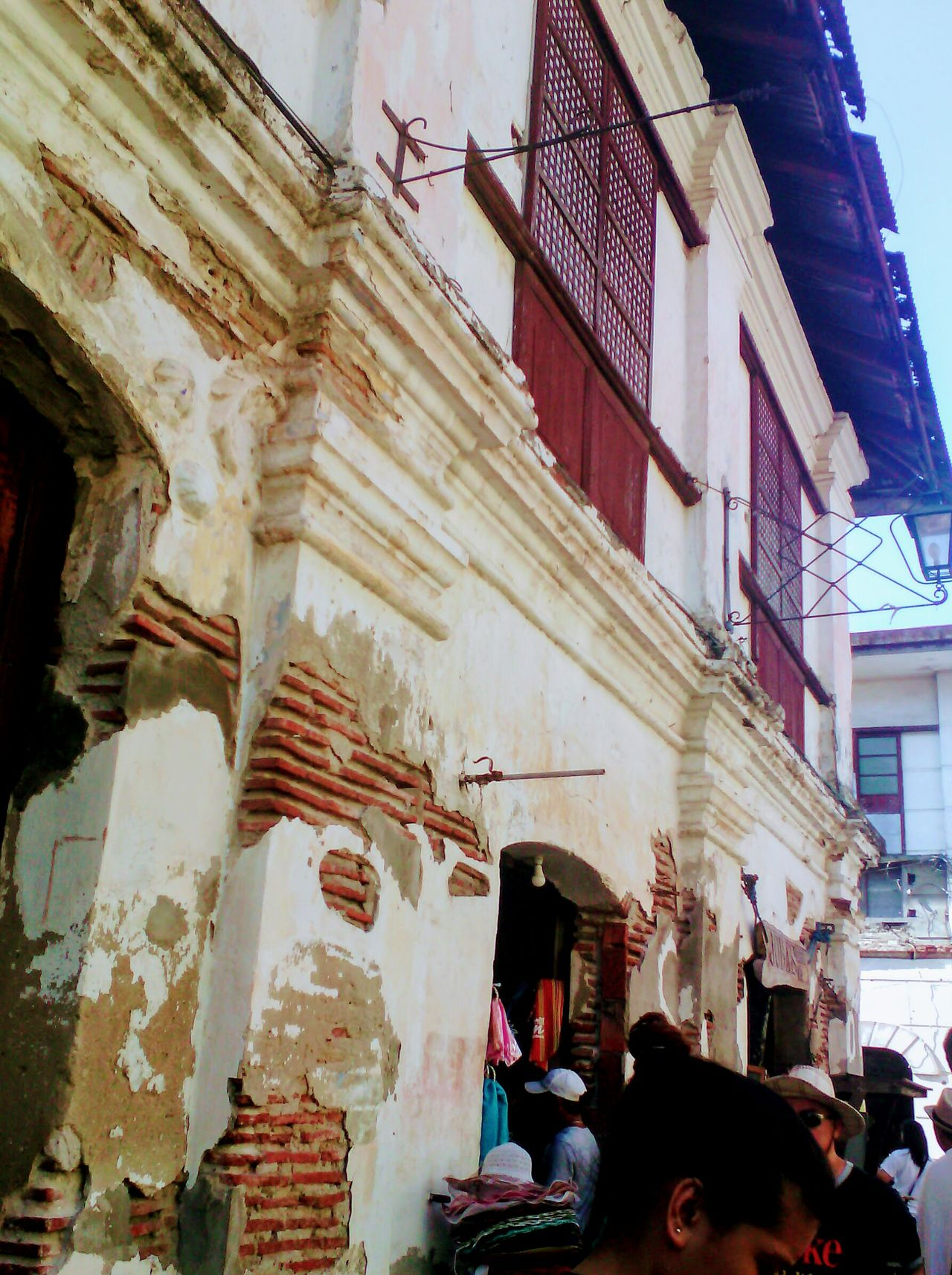 Architecture Built Structure Building Exterior History Low Angle View Day Outdoors Adults Only People Travel Destinations Adult City Real People Sky Vigan Philippines Vintage Shopping Vintage Moments Historical Building Eyemphilippines Outdoor Photography Street Photography Vigan City Philippines Historical Place Architecture Tradingplaces