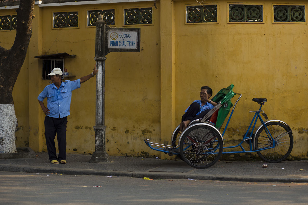 two tricycle driver waiting for customer in Hoi An Vietnam ASIA Asian Culture Bicycle City Life Destination Discovery Hoi An Mode Of Transport People People And Places Street Taxi Tourist Destination Tradition Traditional Culture Transportation Travel Vietnam Voyage