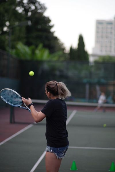 Tennis Tennis Racket Tennis Ball Court Real People Sport Focus On Foreground One Person Playing Lifestyles Leisure Activity Outdoors Tennis Net Holding Day Standing Built Structure Women Sports Clothing Racket Sport
