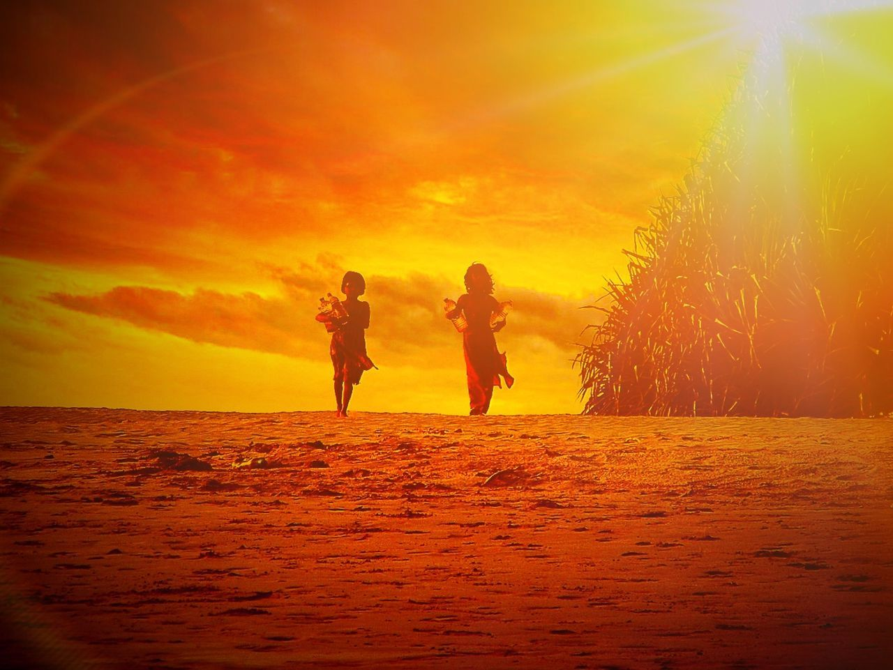 sunset, two people, togetherness, real people, leisure activity, full length, water, sea, nature, beauty in nature, lifestyles, silhouette, scenics, men, outdoors, vacations, women, bonding, standing, friendship, sky, young women, horizon over water, day, young adult, adult, people