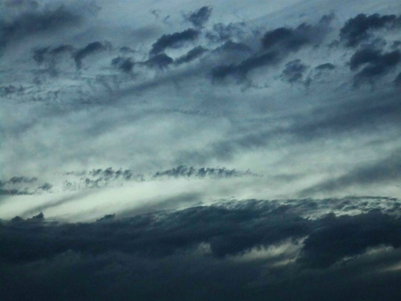cloud - sky, beauty in nature, nature, weather, dramatic sky, sky only, cloudscape, storm cloud, scenics, sky, atmospheric mood, meteorology, backgrounds, storm, low angle view, tranquility, no people, idyllic, majestic, full frame, outdoors, tranquil scene, abstract, silhouette, awe, day, thunderstorm