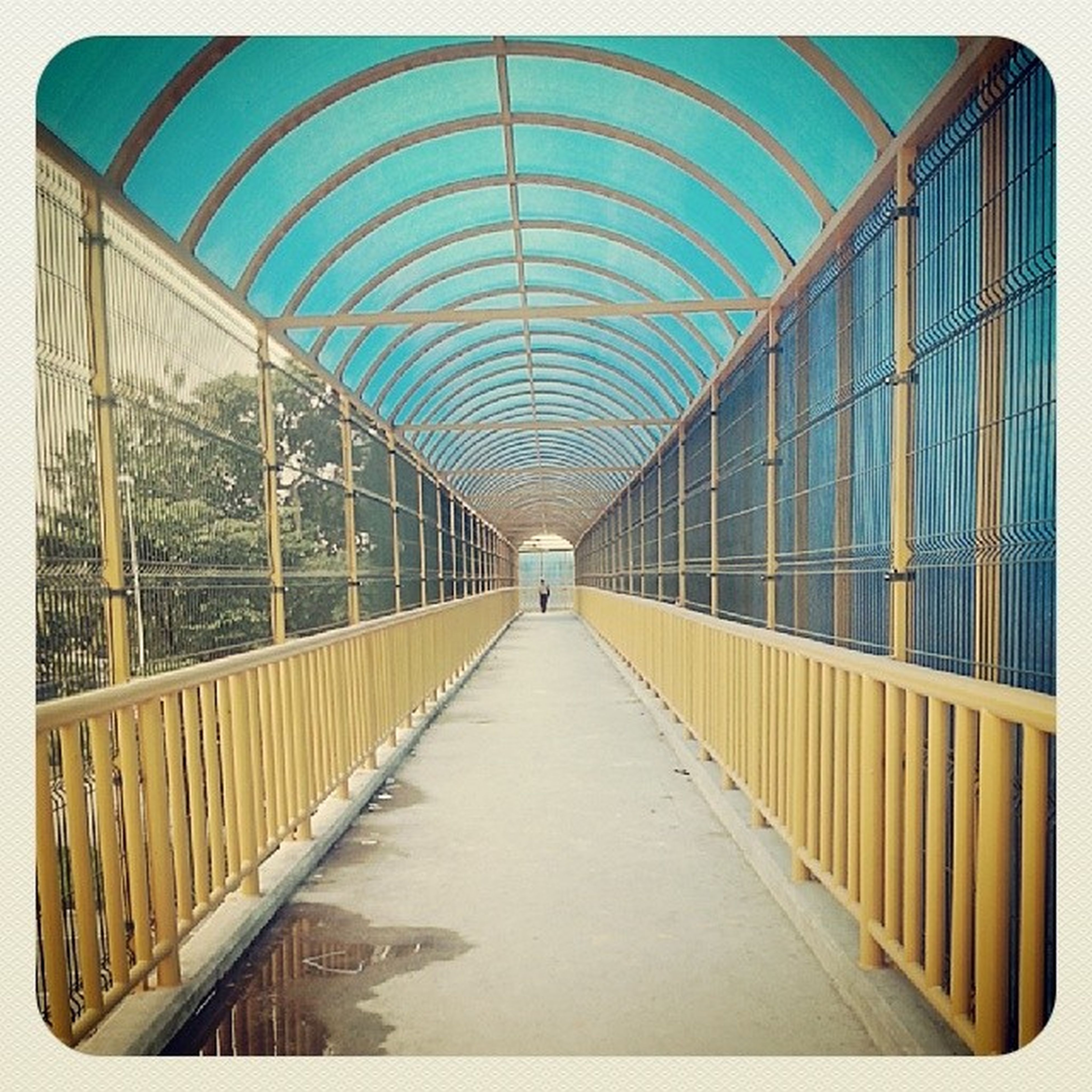 architecture, built structure, the way forward, transfer print, diminishing perspective, vanishing point, auto post production filter, railing, indoors, empty, modern, connection, ceiling, day, footbridge, bridge - man made structure, incidental people, walkway, building exterior, metal