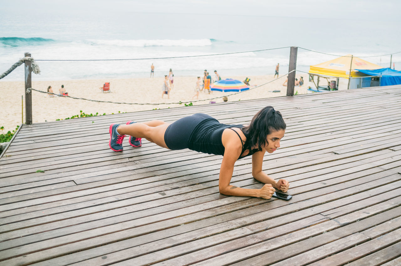 Adult Athlete Beach Brazil Day Exercising Florianópolis Full Length Healthy Lifestyle Leisure Activity Lifestyles Muscular Build Nature One Person Outdoors Real People Sky Sport Sports Clothing Strength Vitality Wellbeing Women Young Adult Young Women