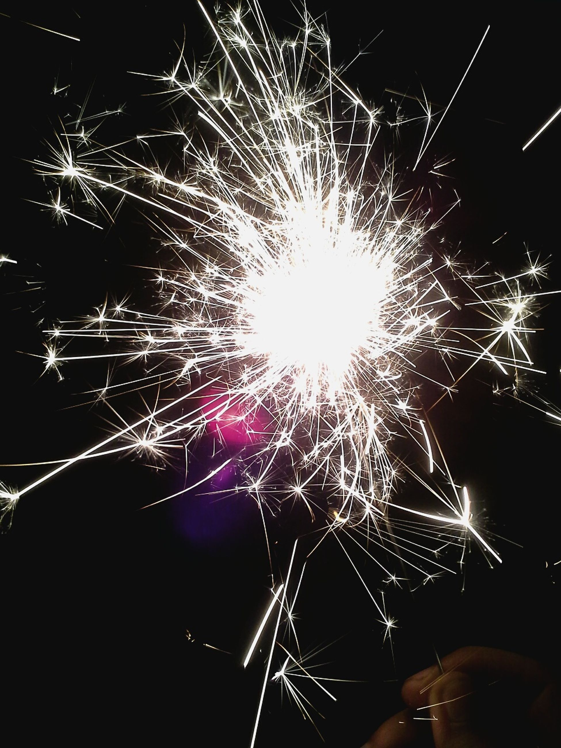 celebration, motion, exploding, long exposure, firework display, blurred motion, arts culture and entertainment, sparks, multi colored, firework - man made object, night, outdoors, no people, smoke - physical structure, sparkler, event, illuminated, sky, firework