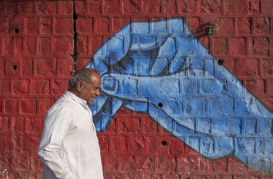 Art Blue Brick Wall Built Structure Casual Clothing Close-up Day Juxtaposition Kumbhmela Multi Colored Outdoors People Red Simhastha Festival ,Ujjain ,India Ujjain Walking EyeemphotoWall Painting Colours Of Life Eyeemphoto TakeoverContrast Art Is Everywhere