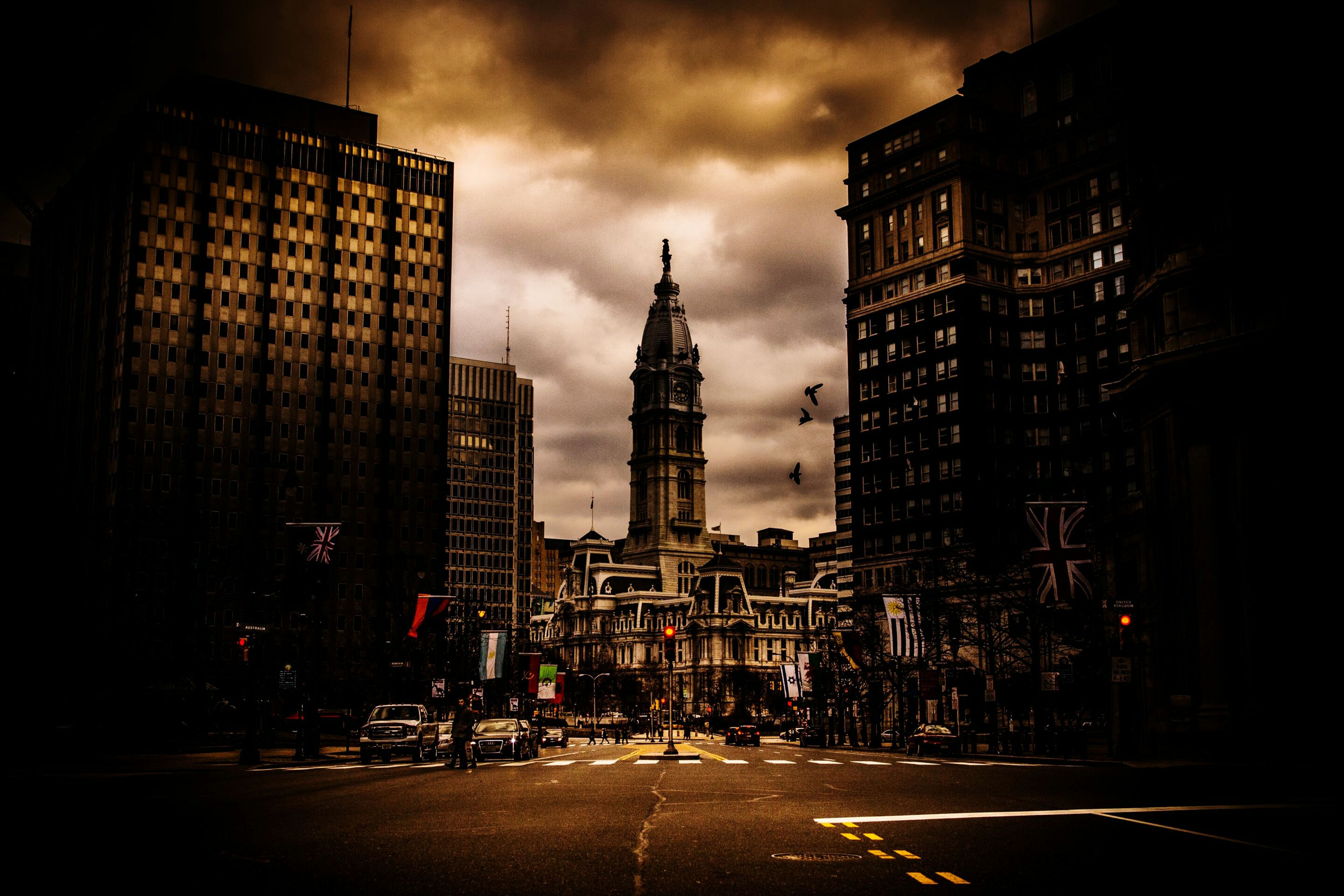 building exterior, architecture, built structure, city, sky, tower, tall - high, street, skyscraper, capital cities, cloud - sky, travel destinations, illuminated, city life, famous place, road, travel, building, dusk, office building