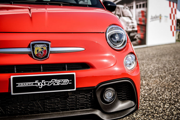 Fiat Abarth 595 red shiny new front view Abarth595 Car Classic Day Design Editorial Use Only Engine Fiat Abarth 595 Mode Of Transport Motor Sport No People Outdoors Racing Red Red Traditional Transportation