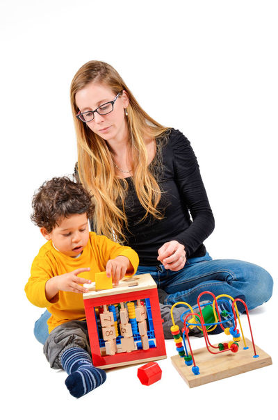 Mother and son are playing together as part of the creative children therapy Adult Autism Child Childhood Creativity Didact Didactic Doctor  Family Fashion Males  Mediterranean  People Protecting Where We Play Terapist Terapy Therapy Togetherness Two People