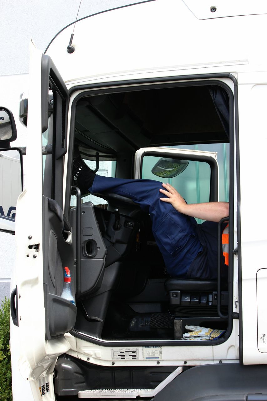 Low Section Of Truck-driver Relaxing In Truck