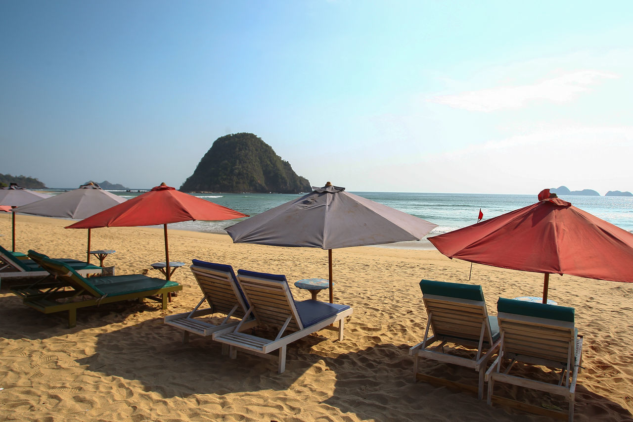 Pulau Merah ,Banyuwangi. ASIA Beach Beach Umbrella Chair Day Horizon Over Water INDONESIA Nature No People Outdoors Parasol Pulaumerah Relaxation Sand Sea Sky Summer Sunlight Tranquil Scene Vacations Water First Eyeem Photo