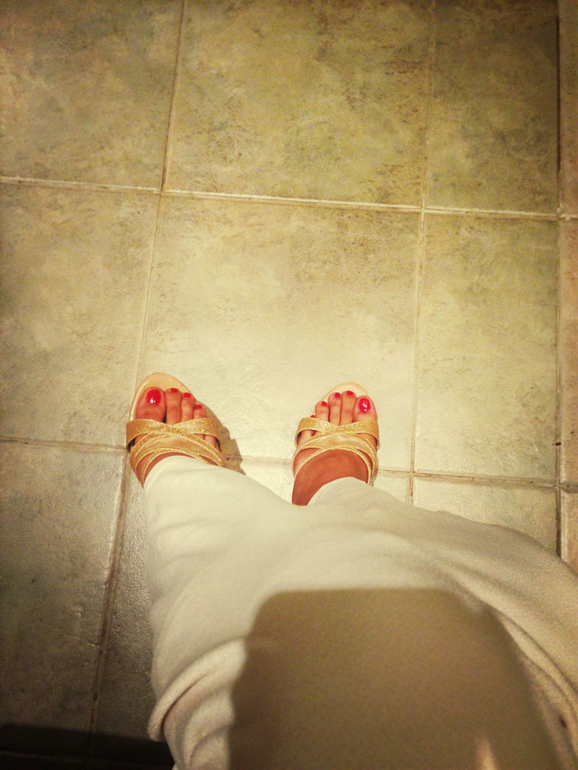 low section, shoe, person, indoors, standing, red, footwear, tiled floor, flooring, high angle view, personal perspective, lifestyles, human foot, men, tile, floor, wall - building feature