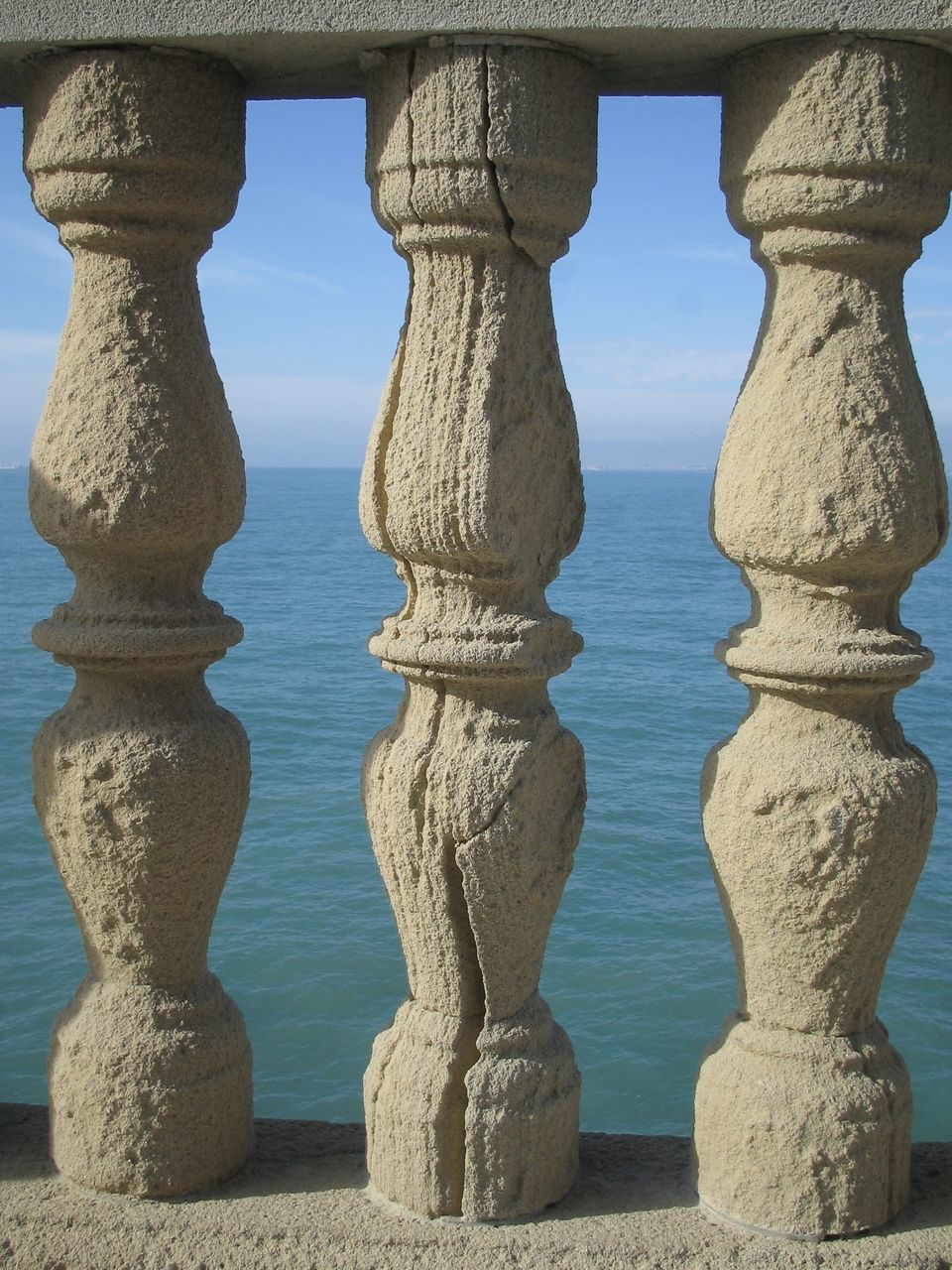 no people, outdoors, travel destinations, day, architectural column, water, sea, built structure, nature, sky, beach, close-up, ancient civilization, architecture