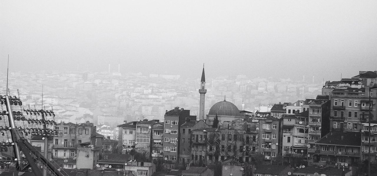 Townscape Against Clear Sky At Foggy Weather