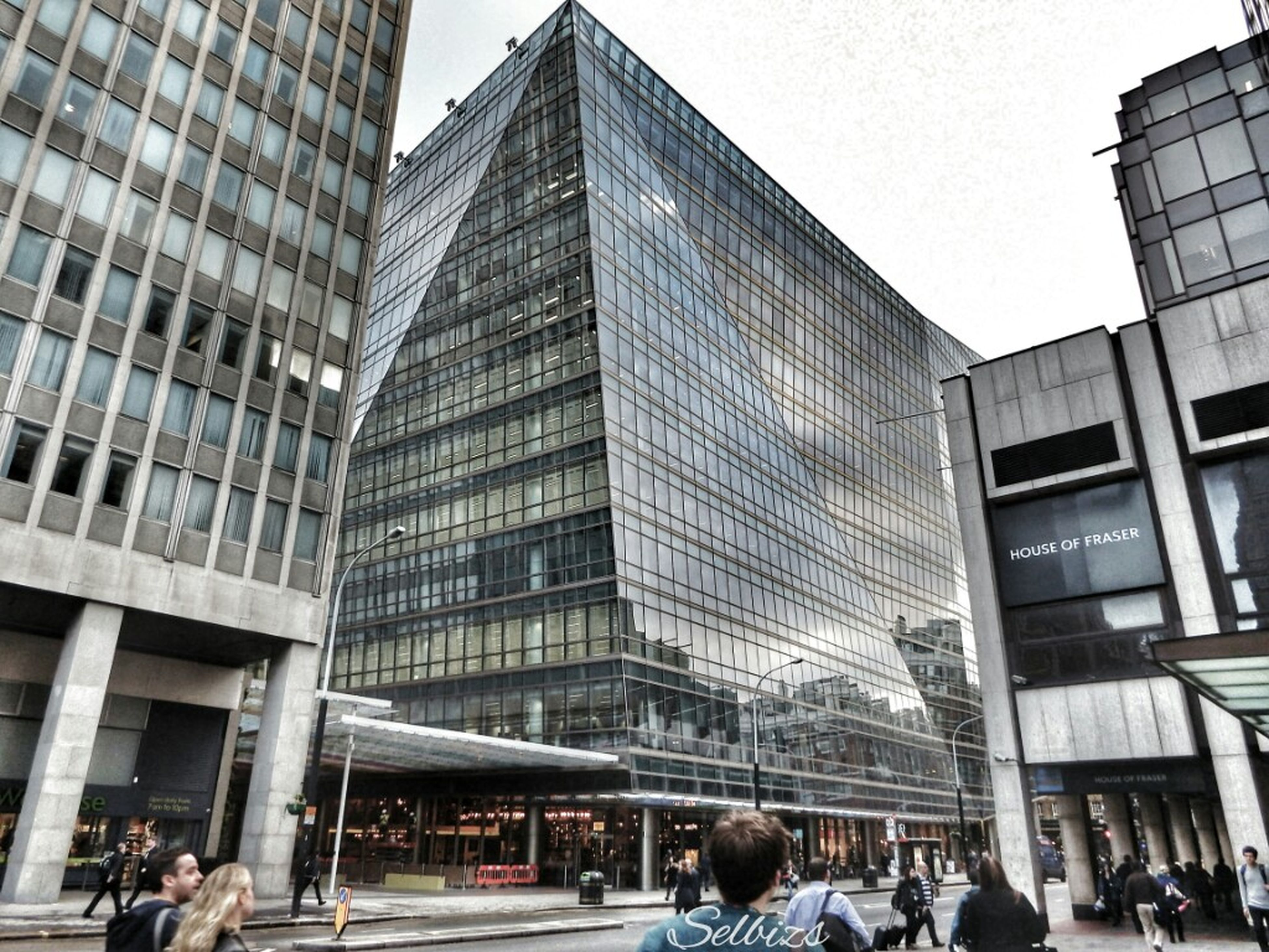 building exterior, architecture, built structure, city, modern, office building, skyscraper, building, glass - material, city life, tall - high, window, low angle view, reflection, tower, sky, day, men, incidental people
