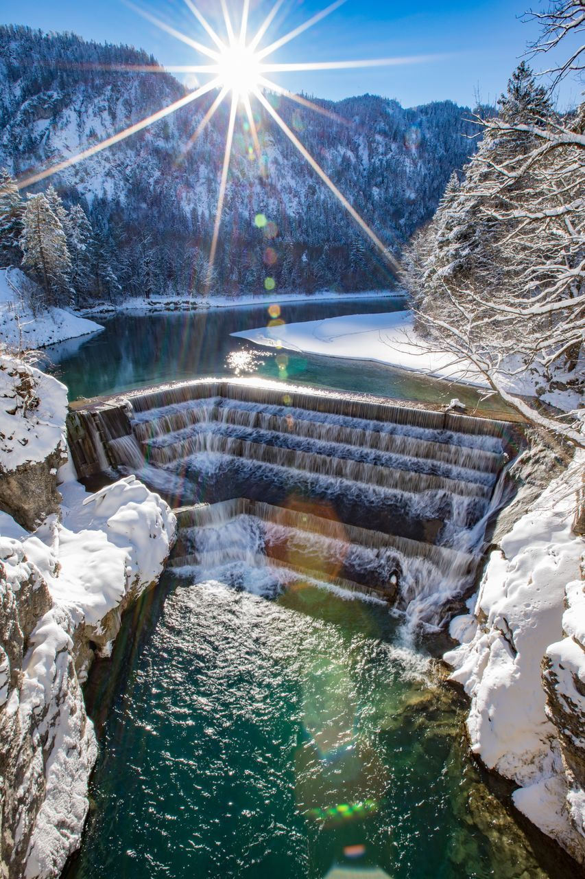 water, nature, winter, beauty in nature, cold temperature, snow, scenics, motion, river, waterfall, no people, outdoors, tree, sunlight, long exposure, day, tranquil scene, sky