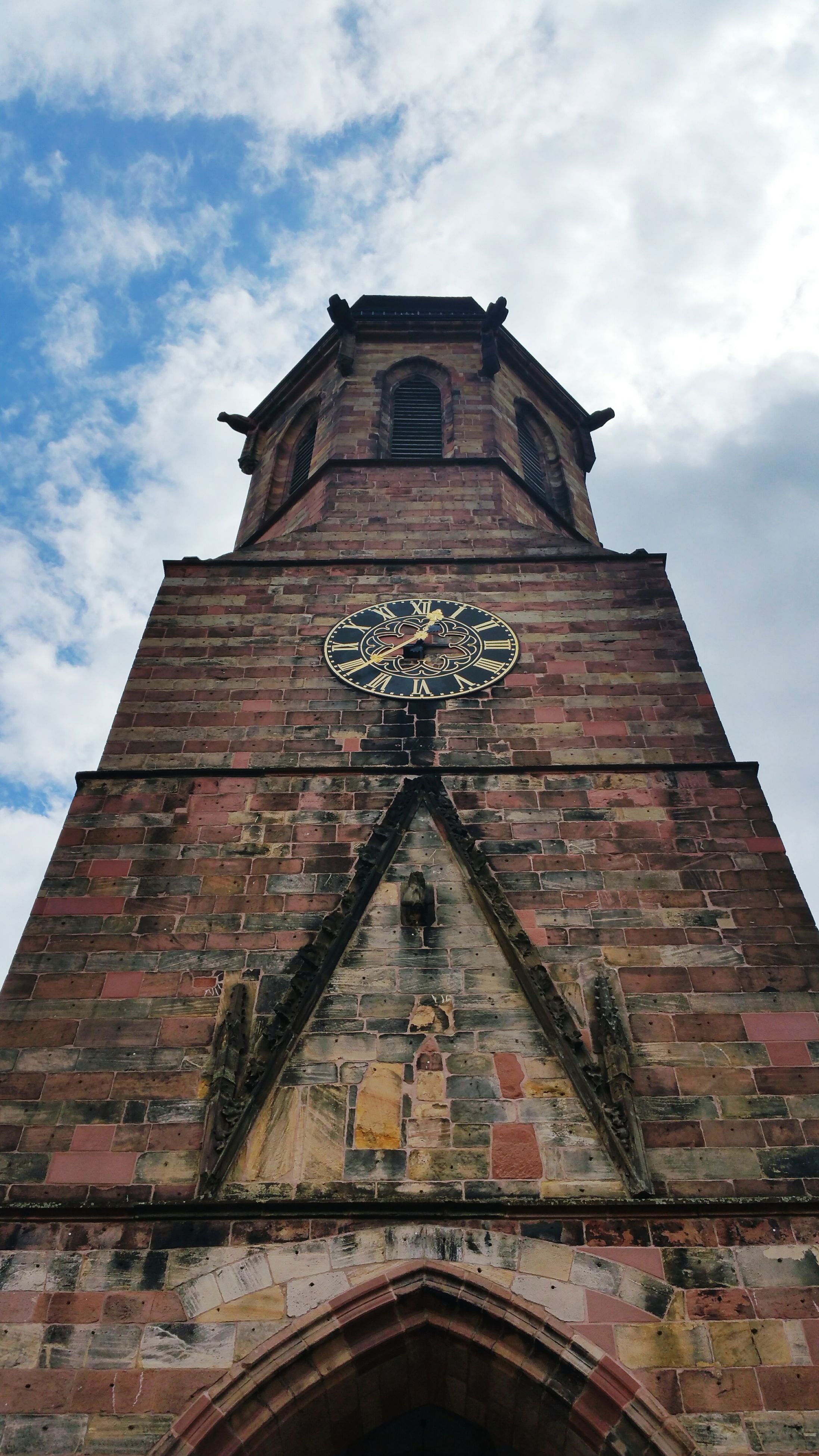 architecture, building exterior, built structure, low angle view, religion, church, place of worship, sky, spirituality, clock tower, clock, cross, cathedral, history, cloud - sky, tower, time, facade