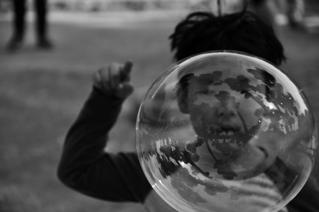 #blackandwhite #Bubble #Child #clouds  #Currently #dream #escape #Eyes #face #FOCUS #Hand #imagination #JustMe #light #photography #realityloss #reflections #Shadow #sky #touch #tree #worldhack Close-up Holding Reflection First Eyeem Photo