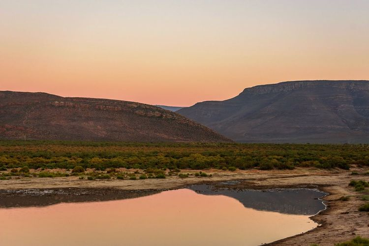 """In Love With Southafrica """" Sunset Beauty In Nature Sunset Scenics Mountain Nature Tranquil Scene Mountain Range Landscape No People Water Desert Tree Arid Climate Outdoors Clear Sky Sky Tranquility Day Colour Your Horizn"""