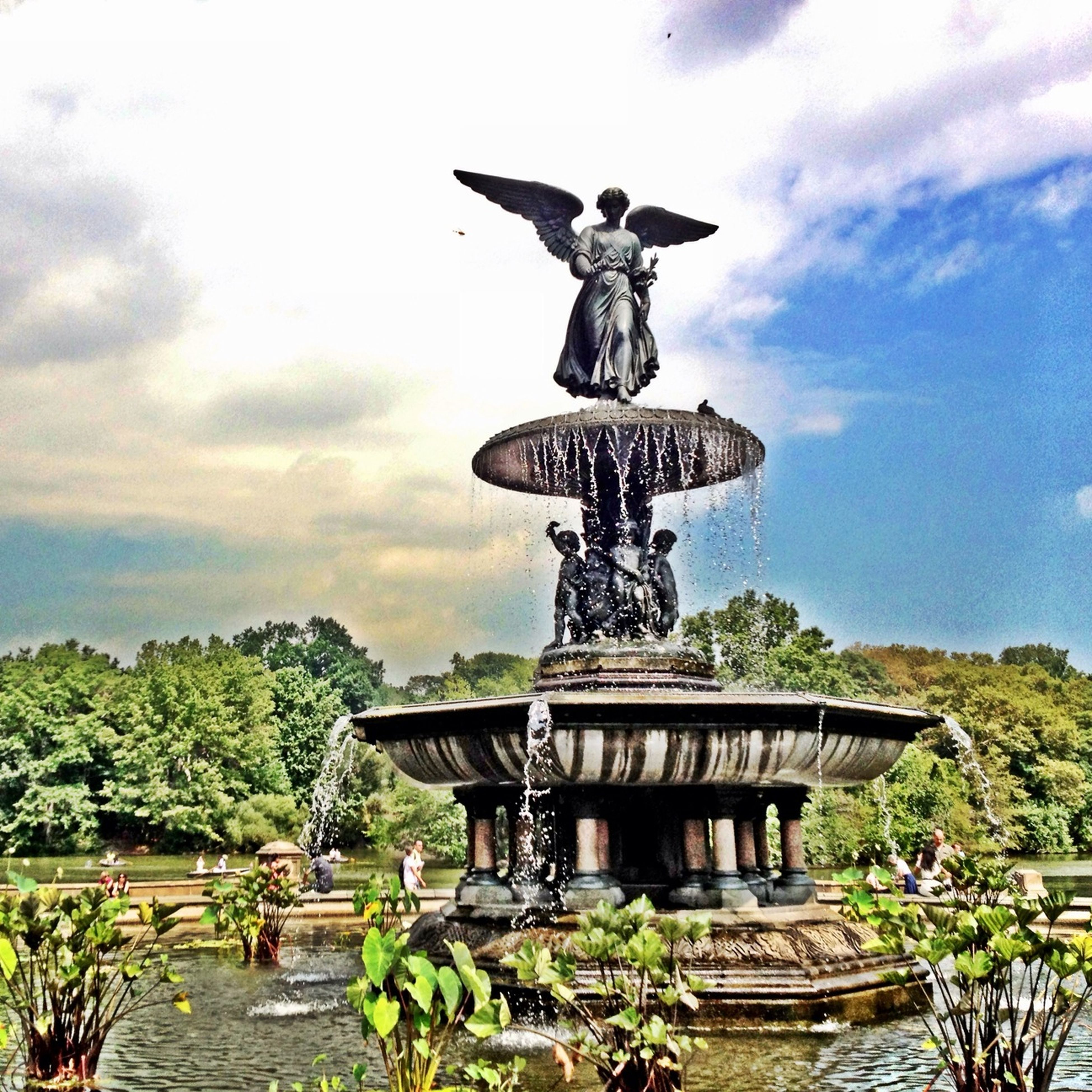 statue, human representation, sculpture, art and craft, art, creativity, sky, animal representation, cloud - sky, tree, low angle view, craft, fountain, monument, famous place, travel destinations, memorial, built structure